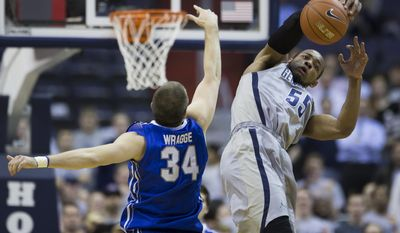 Creighton forward Ethan Wragge (34) and Georgetown guard Jabril Trawick (55) fight for a loose ball during the first half of an NCAA basketball game on Tuesday, March 4, 2014, in Washington. (AP Photo/ Evan Vucci)