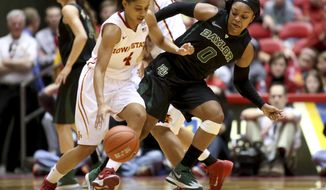 Baylor guard Odyssey Sims tries to work through a screen as she defends Iowa State guard Nikki Moody during the second half of an NCAA college basketball game in Ames, Iowa, Tuesday, March 4, 2014. Baylor won 70-54. (AP Photo/Justin Hayworth)