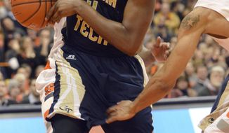Georgia Tech's Robert Carter Jr. grabs a rebound in front of Syracuse's C. J. Fair and Michael Gbinije, right, during the second half of an NCAA college basketball game in Syracuse, N.Y., Tuesday, March 4, 2014. Georgia Tech won 67-62. (AP Photo/Kevin Rivoli)
