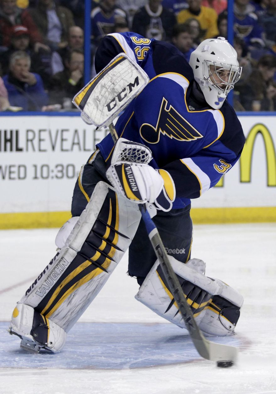 St. Louis Blues goalie Ryan Miller (39) sweeps away the puck during the first period of an NHL hockey game against the Tampa Bay Lightning, Tuesday, March 4, 2014 in St. Louis.(AP Photo/Tom Gannam)