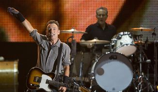** FILE ** In this Sept. 22, 2013, file photo, Bruce Springsteen performs during the Rock in Rio music festival in Rio de Janeiro. Springsteen will headline the NCAA March Madness Music Festival next month in Dallas. (AP Photo/Felipe Dana, File)