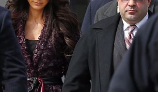 """Teresa, left, and Joe Giudice, from """"The Real Housewives of New Jersey,"""" leave federal court in Newark, N.J. on Tuesday, March 4, 2014. They each pleaded guilty to several counts including bankruptcy fraud, conspiracy to commit mail fraud and wire fraud, and failing to pay taxes. (AP Photo/Rich Schultz)"""