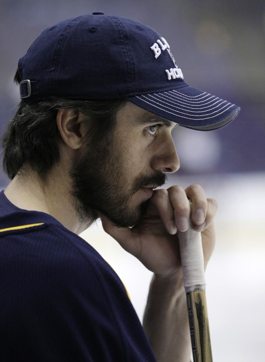 Newly acquired St. Louis Blues' goalie Ryan Miller (39) takes a quiet moment staring at the ice before warm ups, before an NHL hockey game against the Tampa Bay Lightning, Tuesday, March 4, 2014 in St. Louis.(AP Photo/Tom Gannam)