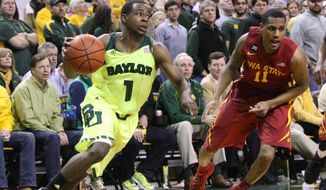 Baylor guard Kenny Chery drives on Iowa State's Monte Morris during the first half of an NCAA college basketball game, Tuesday, March 4, 2014, in Waco, Texas. Baylor won 74-61. (AP Photo/Waco Tribune Herald, Michael Bancale)