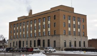 This Jan. 9, 2014 photo shows the federal courthouse building in Aberdeen, S.D. U.S. District Judge Charles Kornmann and his staff have vacated the building. The city bought the building from a private owner last year in an effort to bring it up to U.S. General Services Administration standards so the court can move back in. (AP Photo/Dirk Lammers)