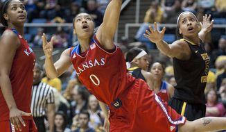 Kansas' Asia Boyd (0) drives to the basket during the first half of an NCAA college basketball game against West Virginia, Tuesday, March 4, 2014, in Morgantown, W.Va. (AP Photo/Andrew Ferguson)
