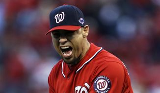 Washington Nationals relief pitcher Mike Gonzalez yells after giving up a solo home run to St. Louis Cardinals' Carlos Beltran during the sixth inning in Game 2 of baseball's National League division series, Monday, Oct. 8, 2012, in St. Louis. (AP Photo/Jeff Roberson)
