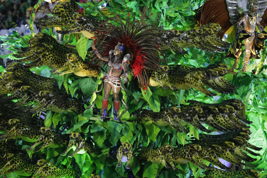 Performers from the Unidos da Tijuca samba school parade during carnival celebrations at the Sambadrome in Rio de Janeiro, Tuesday, March 4, 2014. (AP Photo/Nelson Antoine)