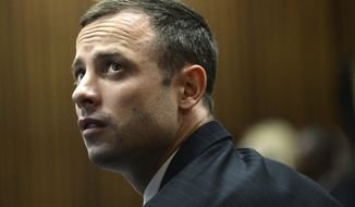 Oscar Pistorius sits in the dock on the second day of his trial at the high court in Pretoria, South Africa, Tuesday, March 4, 2014. Pistorius is charged with murder for the shooting death of his girlfriend, Reeva Steenkamp, on Valentines Day in 2013. (AP Photo/Antoine de Ras, Pool)