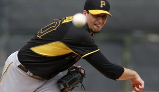 Pittsburgh Pirates starting pitcher Charlie Morton warms up before the second inning of an exhibition baseball game against the Detroit Tigers in Lakeland, Fla.,  Tuesday, March 4, 2014. The Pirates won 5-2. (AP Photo/Gene J. Puskar)