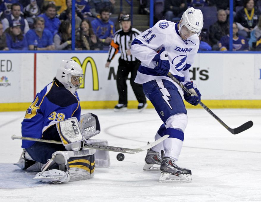 St. Louis Blues goalie Ryan Miller (39) makes a stick save on a redirected puck from Tampa Bay Lightning's Tom Pyatt (11) during the first period of an NHL hockey game, Tuesday, March 4, 2014 in St. Louis.(AP Photo/Tom Gannam)
