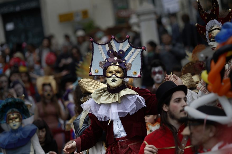Revelers take part in a Carnival parade in downtown Lisbon, Tuesday March 4, 2014. (AP Photo/Francisco Seco)