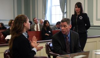 High school senior Rachel Canning, 18, left, talks with her father, Sean Canning, during a break in proceedings, in Morris County Superior Court in Morristown, N.J., Tuesday, March 4, 2014. Rachel Canning is suing her parents for financial support and college tuition after she claims they threw her out of the home. (AP Photo/Daily Record, Bob Karp, Pool)