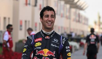 Formula One driver Daniel Ricciardo of Red Bull Racing walks in the paddock during pre-season testing at the Bahrain International Circuit in Sakhir, Bahrain, on Thursday, Feb. 27, 2014. (AP Photo/Hasan Jamali)