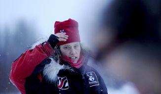 Aliy Zirkle talks about the snowless trail across the Farewell Burn at the Nikolai checkpoint during the 2014 Iditarod Trail Sled Dog Race on Tuesday, March 4, 2014, in Nikolai, Alaska. (AP Photo/The Anchorage Daily News, Bob Hallinen)