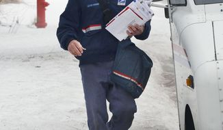 ADVANCE FOR USE SUNDAY, MARCH 9 AND THEREAFTER - In this Feb. 20, 2014 photo, U.S. Postal Service letter carrier Gary Keist walks through deep snow during his route Normal, Ill. Keist, 56, began as a letter carrier in 1978 and said this winter is the worst he's ever worked because of the consistent pattern of snowfalls followed by bitterly cold temperatures with little or no break. (AP Photo/The Pantagraph, Steve Smedley)