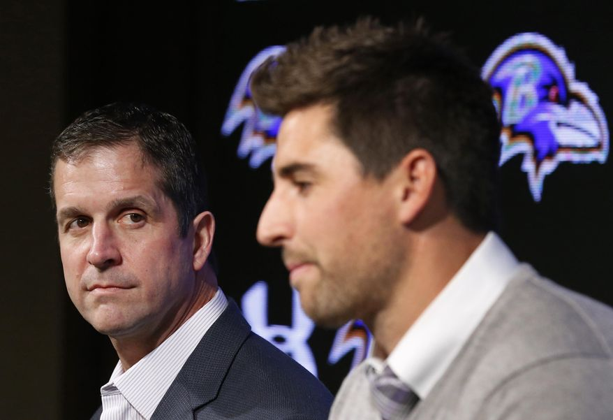 Baltimore Ravens head coach John Harbaugh, left, listens as tight end Dennis Pitta discusses his new five-year contract during an NFL football news conference, Wednesday, March 5, 2014, at the Ravens practice facility in Owings Mills, Md.  (AP Photo/Patrick Semansky)