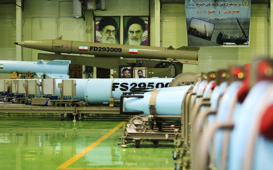 This photo released on Wednesday, March 5, 2014 by the Iranian Defense Ministry, purports to show missiles Fateh-110, top, and Persian Gulf, bottom, in an undisclosed location in Iran. Iran's powerful Revolutionary Guard on Wednesday said it had acquired missiles with multiple warheads, the latest armaments advance to be claimed by the Islamic Republic. At a ceremony Wednesday, Defense Minister Hossein Dehghan presented a delivery of four types of ballistic missiles - named Qiam, Qadr H1, Fateh-110 and Persian Gulf. (AP Photo/Iranian Defense Ministry)
