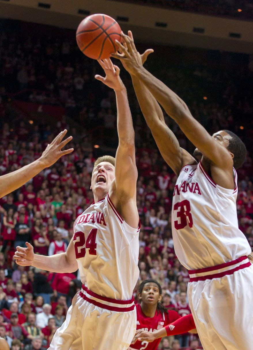 Indiana's Jeff Howard (24) and Jeremy Hollowell (33) go after a rebound in the first half of an NCAA college basketball game, Wednesday, March 5, 2014, in Bloomington, Ind. (AP Photo/Doug McSchooler)