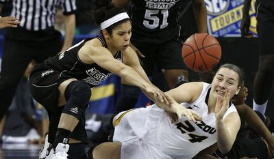 Mississippi State guard Dominique Dillingham (00) and Missouri guard Sierra Michaelis (24) reach for a loose ball in the first half of a first-round Women's Southeastern Conference Tournament NCAA college basketball game Wednesday, March 5, 2014, in Duluth, Ga. (AP Photo/John Bazemore)