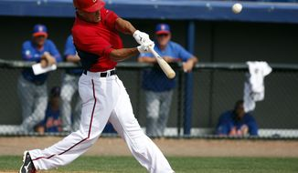Washington Nationals' Ian Desmond hits a solo home run in the third inning of a spring exhibition baseball game against the New York Mets, Wednesday, March 5, 2014, in Viera, Fla. (AP Photo/Alex Brandon)