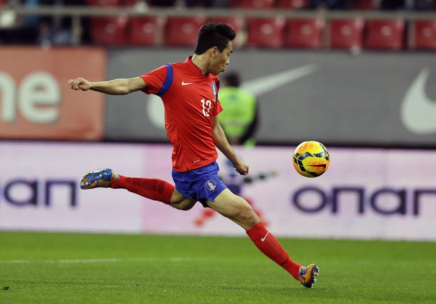 South Korea's Park Chu-young scores the opening goal against Greece during a friendly match at Georgios Karaiskakis stadium in Piraeus port, near Athens, Wednesday, March 5, 2014. (AP Photo/Thanassis Stavrakis)