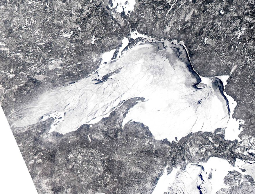 In this Feb. 16, 2014 satellite image provided by the NOAA Great Lakes CoastWatch is the ice cover on Lake Superior. The Army Corps of Engineers said Wednesday, March 5, 2014 that the heavy ice cover and snowfall across the Great Lakes basin should help water levels move closer to normal over the next six months. (AP Photo/NOAA Great Lakes CoastWatch)