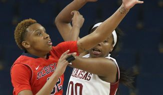 Mississippi forward Tia Faleru (32) and Arkansas forward Jessica Jackson (00) battle for a rebound in the first half of a first-round women's Southeastern Conference tournament NCAA college basketball game Wednesday, March 5, 2014, in Duluth, Ga.  (AP Photo/Jason Getz)