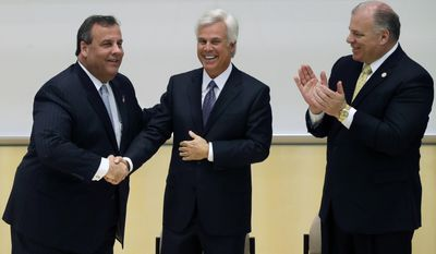 As New Jersey Senate President Stephen M. Sweeney, D-West Deptford, N.J., right, looks on, New Jersey Gov. Chris Christie, left, shakes hands with George E. Norcross III, at a groundbreaking ceremony Wednesday, March 5, 2014, in Camden, N.J., for a new kind of school that Norcross' family foundation will help fund. Norcross, a powerful New Jersey Democrat complimented the governor at the groundbreaking ceremony. His kind words came only after he teased Christie about a scandal revolving around traffic jams near the George Washington Bridge. Norcross says he, unlike the governor, has the power to shut down a bridge. The Ben Franklin is closed for a few hours each November for a charity-run sponsored by Norcross.  (AP Photo/Mel Evans)