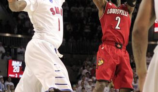 Louisville guard Russ Smith (2) shoots a jumper over SMU guard Ryan Manuel (1) during the first half of an NCAA college basketball game Wednesday, March 5, 2014, in Dallas. Louisville won 84-71.  (AP Photo/John F. Rhodes)