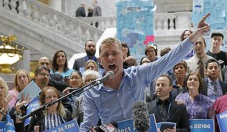 Troy Williams speaks during an news conference and rally Wednesday, March 5, 2014, at the Utah State Capitol, in Salt Lake City. Protesters pushing for Utah to adopt a statewide anti-discrimination law protecting sexual and gender orientation returned to the state Capitol three weeks after they were arrested for blocking entrances to committee rooms. The group held a news conference Wednesday afternoon to continue pressing for the law, which has been stalled this session. Republican leaders at the Legislature have called for a moratorium this year on any issues they fear could affect the state's pending legal challenge over its same-sex marriage ban.  (AP Photo/Rick Bowmer)