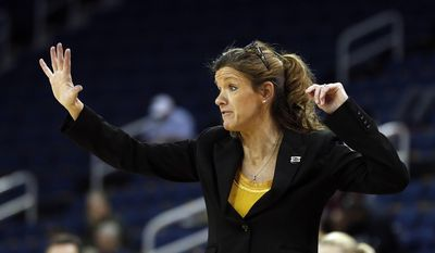Missouri head coach Robin Pingeton directs her team in the second half of a first-round women's Southeastern Conference tournament NCAA college basketball game against the Mississippi State  Wednesday, March 5, 2014, in Duluth, Ga. Mississippi State won 73-70. (AP Photo/John Bazemore)