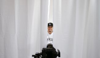 10ThingstoSeeSports - Colorado Rockies left fielder Carlos Gonzalez poses during the team photo day before a spring training baseball workout Wednesday, Feb. 26, 2014, in Scottsdale, Ariz.  (AP Photo/ Gregory Bull, File)