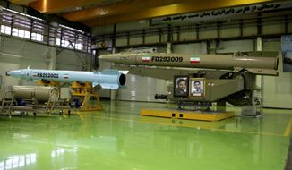 This photo released on Wednesday, March 5, 2014 by the Iranian Defense Ministry, purports to show missiles Fateh-110, right, and Persian Gulf in an undisclosed location in Iran. Iran's powerful Revolutionary Guard on Wednesday said it had acquired missiles with multiple warheads, the latest armaments advance to be claimed by the Islamic Republic. At a ceremony Wednesday, Defense Minister Hossein Dehghan presented a delivery of four types of ballistic missiles - named Qiam, Qadr H1, Fateh-110 and Persian Gulf. (AP Photo/Iranian Defense Ministry)