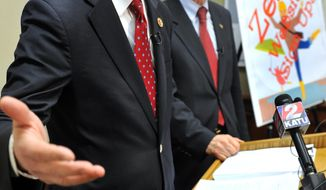 FILE - This Feb. 13, 2014 file photo shows U.S. Rep Greg Walden, R-Ore., announcing a request form U.S. House Republicans for the U.S. Government Accountability Office to investigate how $304 million in federal grants was spent on the troubled Cover Oregon online enrollment system for the federal health insurance overhaul. With him is state Rep. Dennis Richardson, who is running for governor. Due to similar requests from several members of Congress and committees, the GAO agreed Wednesday, March 5, 2014 to look into problems with state health exchange websites around the country. The agency says which states will be determined as the investigation goes forward. (AP Photo/Mail Tribune, Bob Pennell)