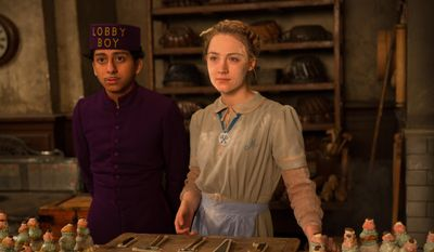 "This image released by Fox Searchlight shows Tony Revolori, left, and Saoirse Ronan in ""The Grand Budapest Hotel.""  (AP Photo/Fox Searchlight)"