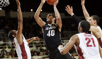 Colorado forward Josh Scott (40) drives to the basket between three Stanford defenders during the first half of an NCAA college basketball game Wednesday, March 5, 2014, in Stanford, Calif. (AP Photo/Marcio Jose Sanchez)