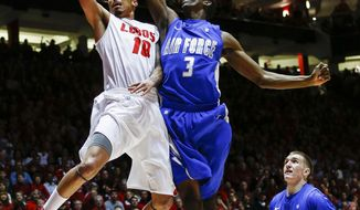 New Mexico's Kendall Williams (10) scores on a break away guarded by Air Force's Justin Hammonds (3) during the first half of an NCAA college basketball game at The Pit in Albuquerque, N.M., Wednesday, March 5, 2014. (AP Photo/Juan Antonio Labreche)