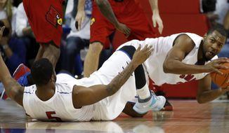 SMU forward Shawn Williams (2) recovers a ball lost by teammate Markus Kennedy (5) during the first half of an NCAA college basketball game against Louisville on Wednesday, March 5, 2014, in Dallas. (AP Photo/John F. Rhodes)