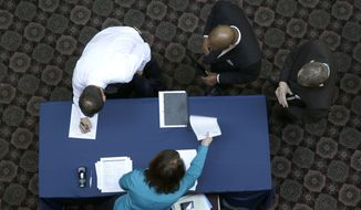 ** FILE ** In this Wednesday, Jan. 22, 2014, file photo, job seekers sign in before meeting prospective employers during a career fair at a hotel in Dallas. (AP Photo/LM Otero, File)