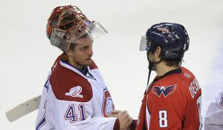 Montreal Canadiens goalie Jaroslav Halak (41), of Slovakia, shakes hands with Washington Capitals left wing Alex Ovechkin (8), of Russia, after the Canadiens eliminated the Capitals from the NHL hockey playoffs with a 2-1 win Wednesday, April 28, 2010, in Washington. (AP Photo/Nick Wass)