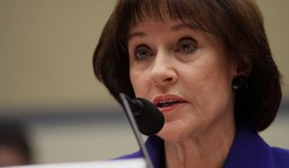 **FILE** Former IRS official Lois Lerner speaks on Capitol Hill in Washington on March 5, 2014, during the House Oversight and Government Reform Committee hearing on the the agency's targeting of tea party groups, where she invoked her constitutional right not to incriminate herself. (Associated Press)
