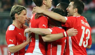 Austria's players react after scoring a goal during a friendly soccer match between Austria and Uruguay, in Klagenfurt, Austria, Wednesday, March 5, 2014. (AP Photo/Ronald Zak)