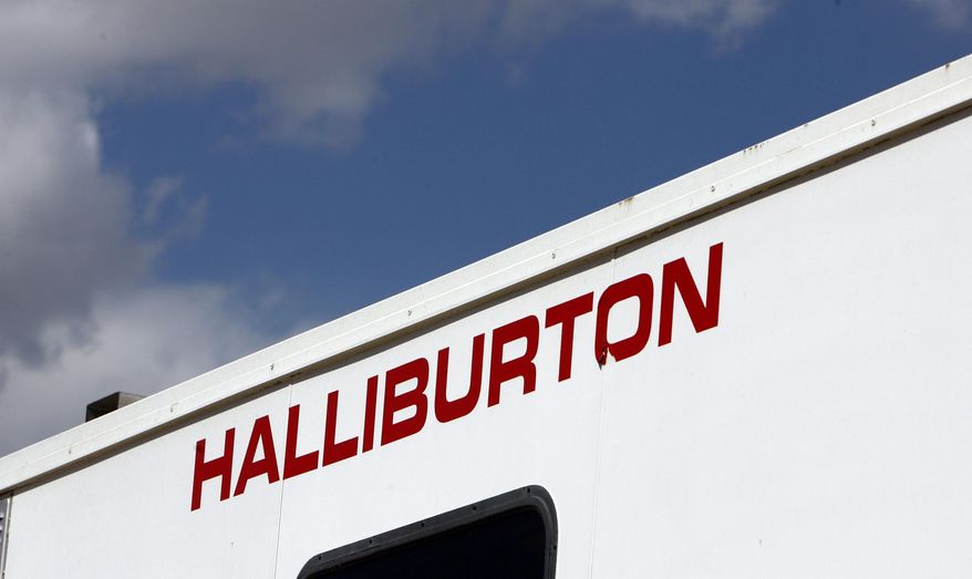 FILE - In this April 15, 2009 file photo, the Halliburton sign adorns the side of a machine being used by the company at a site in Rulison, Colo. The Supreme Court appears open to the idea of modifying a quarter century of precedent to make it harder for investors to join together to sue corporations for securities fraud. The justices heard arguments Wednesday in an appeal by Halliburton Co. that seeks to block a class-action lawsuit claiming the energy services company inflated its stock price. (AP Photo/David Zalubowski, File)