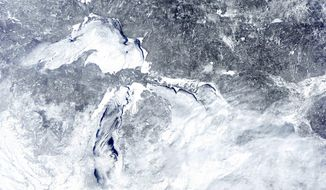 In this Feb. 16, 2014 satellite image provided by the NOAA Great Lakes CoastWatch is the ice cover on the Great Lakes. The Army Corps of Engineers said Wednesday, March 5, 2014 that the heavy ice cover and snowfall across the Great Lakes basin should help water levels move closer to normal over the next six months. (AP Photo/NOAA Great Lakes CoastWatch)