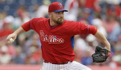 Philadelphia Phillies starter Sean O'Sullivan throws a pitch during the first inning of an exhibition baseball game against the Atlanta Braves on Wednesday, March 5, 2014, in Clearwater, Fla. (AP Photo/Charlie Neibergall)
