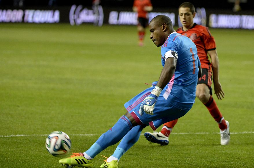 Nigeria goalie Vincent Enyeama (1) blocks in front of Mexico's Javier Hernandez during the first half of an international friendly soccer match Wednesday, March 5, 2014, in Atlanta. (AP Photo/David Tulis)