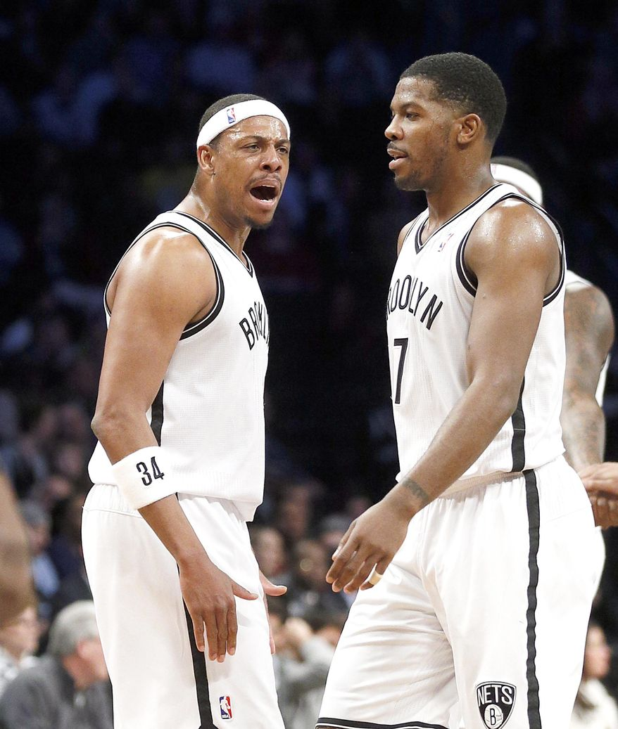 Brooklyn Nets forward Paul Pierce (34) shouts to teammate Joe Johnson (7)  after he scored in the first half of an NBA basketball game against the Memphis Grizzlies on Wednesday, March 5, 2014, in New York. (AP Photo/Paul J. Bereswill)