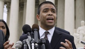 Debo Adegbile, then an attorney with the Legal Defense and Educational Fund of the National Association for the Advancement of Colored People speaks outside the Supreme Court in Washington on April 29, 2009. Adegbile, President Barack Obama's choice to head the Justice Department's civil rights division has failed a Senate test vote and his confirmation is in jeopardy. (Associated Press) **FILE**
