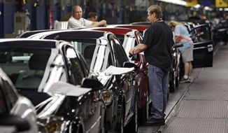 ** FILE ** In this Tuesday, June 15, 2010, photo, workers at General Motors' Lordstown Assembly plant in Lordstown, Ohio put the final touches on Chevy Cobalts. U.S. safety regulators are demanding that General Motors turn over documents detailing what the company knew when about a dangerous ignition problem that has been linked to 13 car-crash deaths. (AP Photo/Mark Duncan, File)